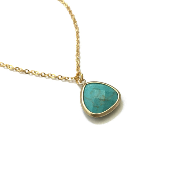 Gold plated framed turquoise howlite pendant necklace