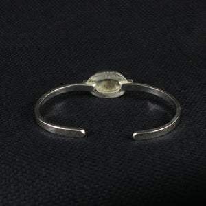 unEarthed cuff with rutilated quartz and tanzanite