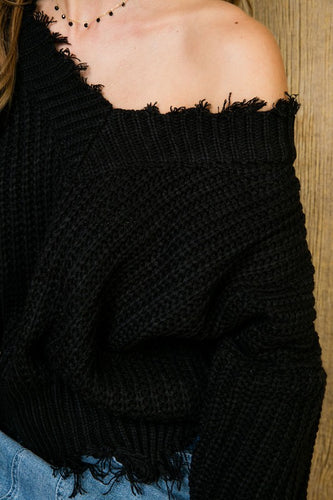 Women's knitted frayed off the shoulder black top