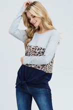 Women's fashion wearing cheetah print long sleeve top with tie in front