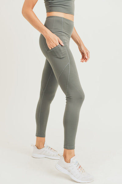 High Waisted Solid Slanted Leggings in Green Metal | Allure Apparel Co