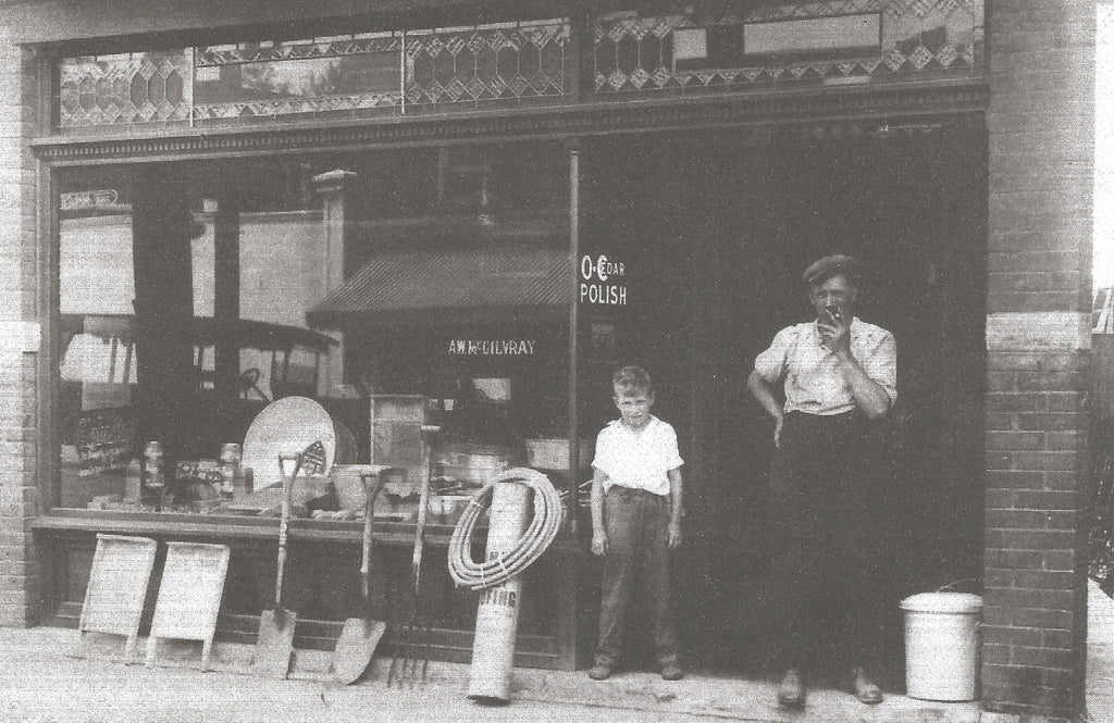 Claude and Watt McGilvray in front of their business at 3095 Dundas St. W in 1920