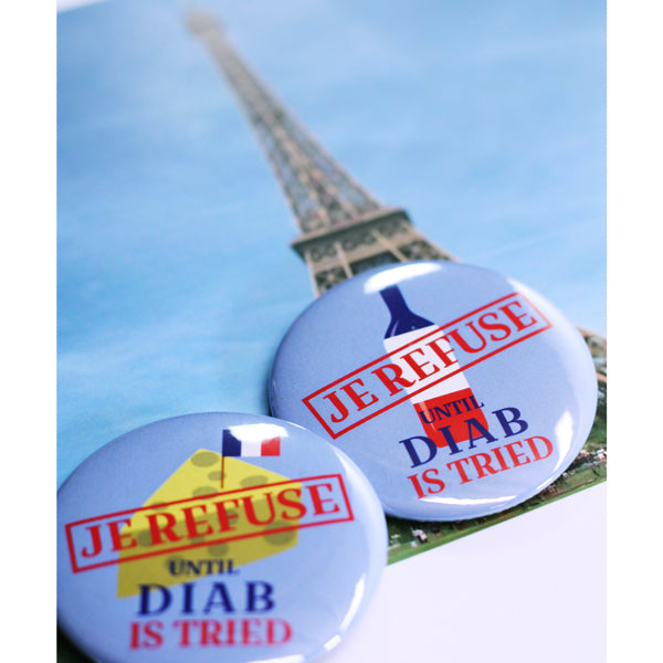 "Je Refuse French made until Diab is tried 2-1/4"" buttons"