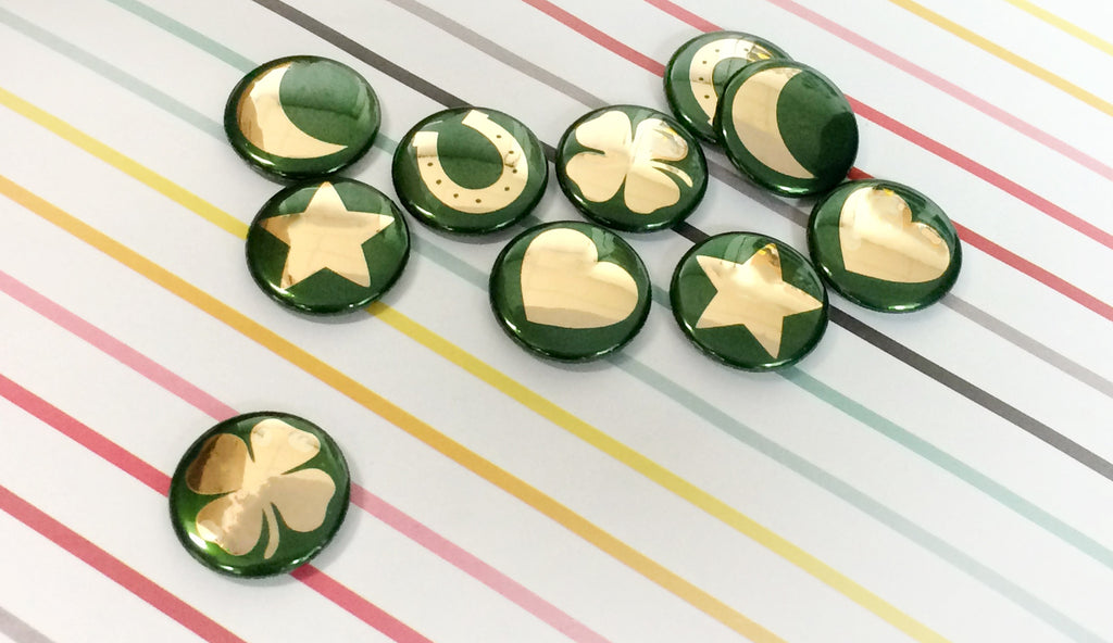 Goil shiney lucky charm buttons for St. Patrick's Day!