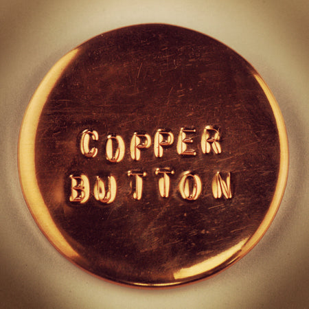 embossed copper pin-back button