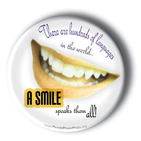 There Are Hundreds Of Languages In The World. A Smile Speaks Them All! - Button/Magnet