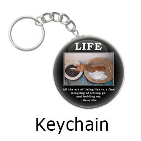 All the art of living lies in the mingling of letting go and holding on. Havelock Ellis quote on funny cat key chain on people power press