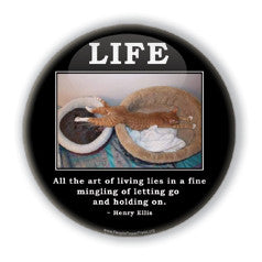 All the art of living lies in the mingling of letting go and holding on. Havelock Ellis quote on funny cat button on people power press