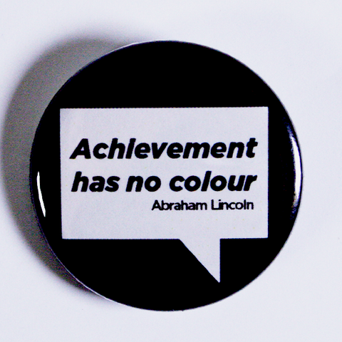 "2-1/4"" button with quote 'Achievement has no colour'"