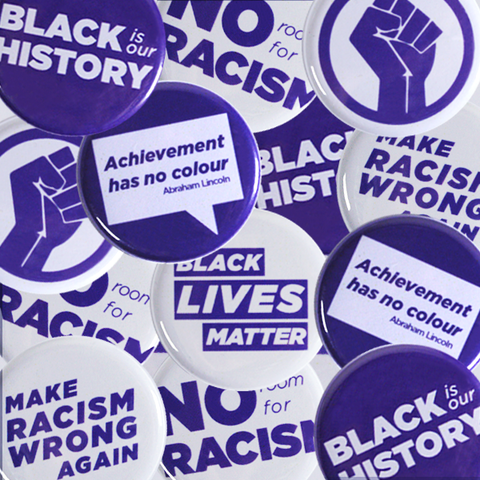 Mix of buttons with Anti-Racism and Black Power designs
