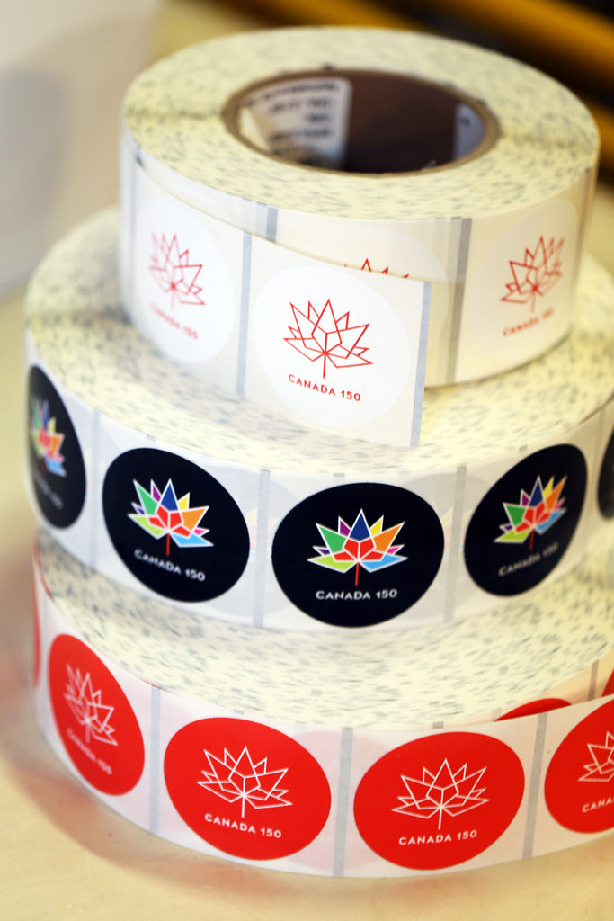 Canada 150 stickers and labels on a roll