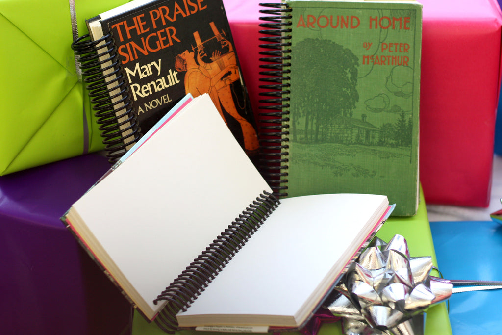 recycled and upcycled notebooks and sketchbooks are repurposed library books that were discard and now have new life