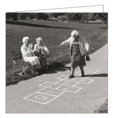 Black & White Ladies Playing Hopscotch