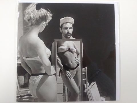 Funny Image of Woman and Man With Mirror