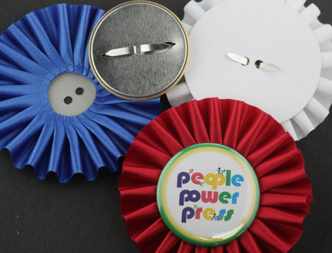 Rosettes for use with prong back buttons