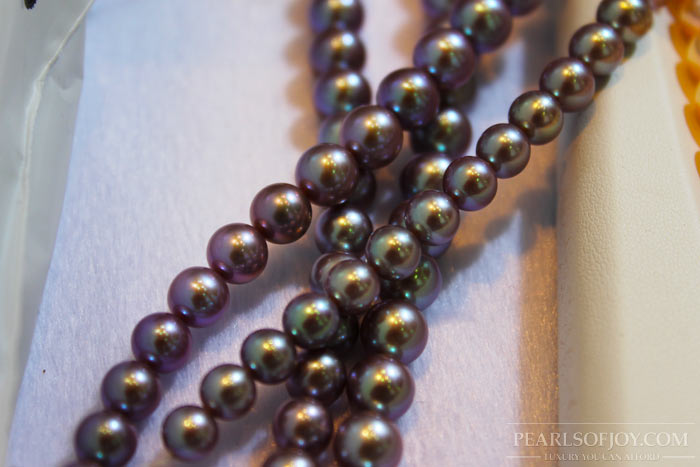 close up of black, metallic pearls