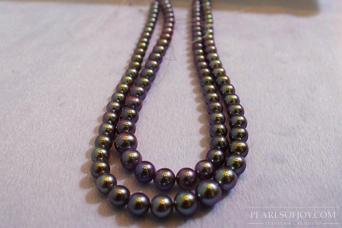 strands of black, freshwater pearls