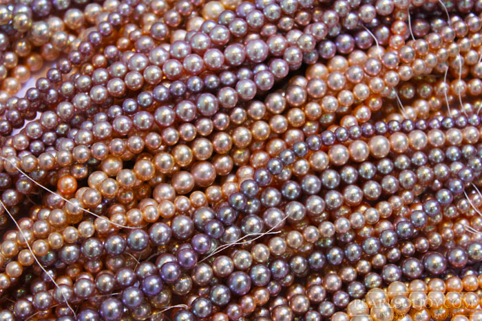 assorted colored strands of metallic pearls
