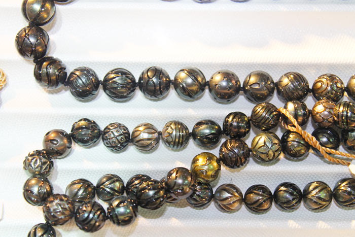 a strand of Galatea pearls with different patterns