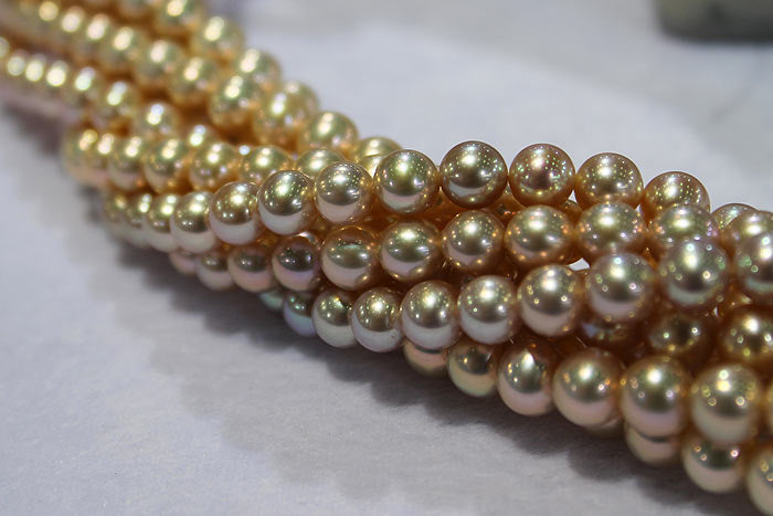 strands of golden metallic pearls