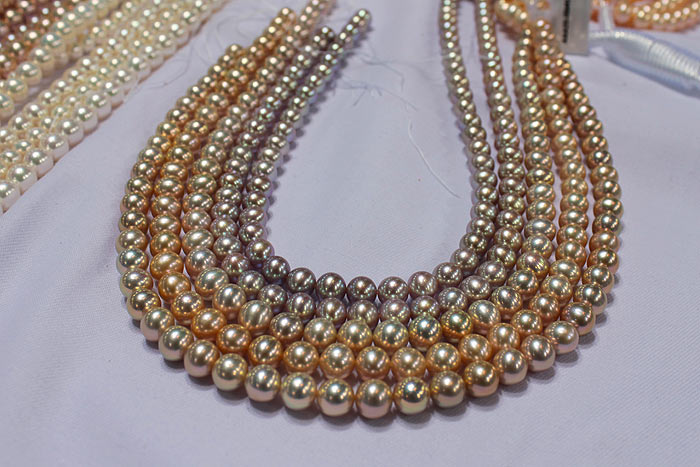 strands of pearls with metallic luster