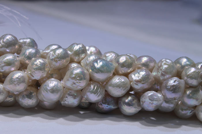 a close up of the huge, white pearls