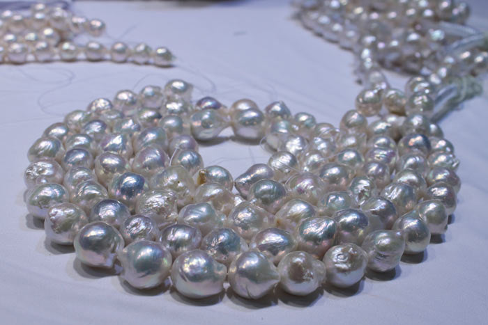 coiled strands of the white pearls