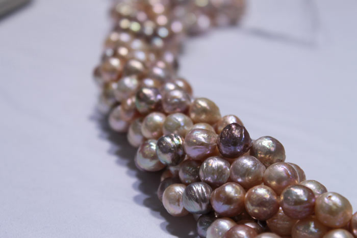 clumped strands of multicolored and peach pearls