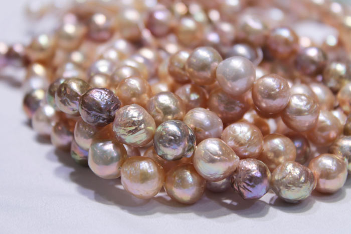 magnified image of the peach and multicolored pearls