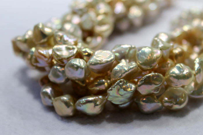clumped strands of golden keshi pearls
