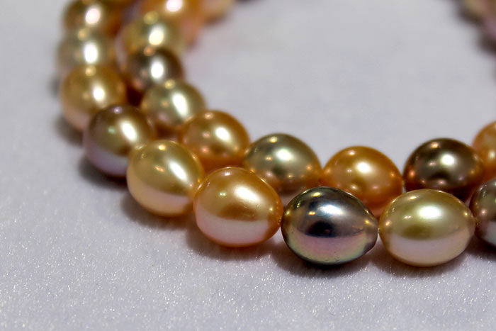 two strands of colorful drop pearls