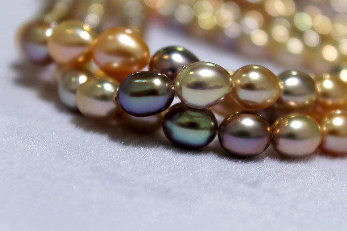 dark and light colored drop pearls