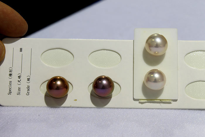 pairs of white and purple metallic round pearls