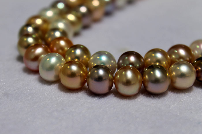a closer look at the round pearls' exquisite metallic luster