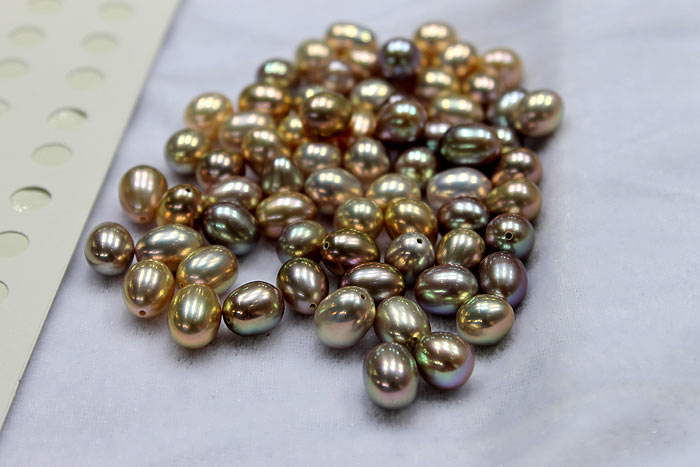 close up of the metallic drop pearls