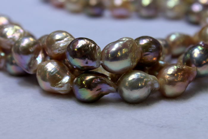 a combination of light and dark colored pearls