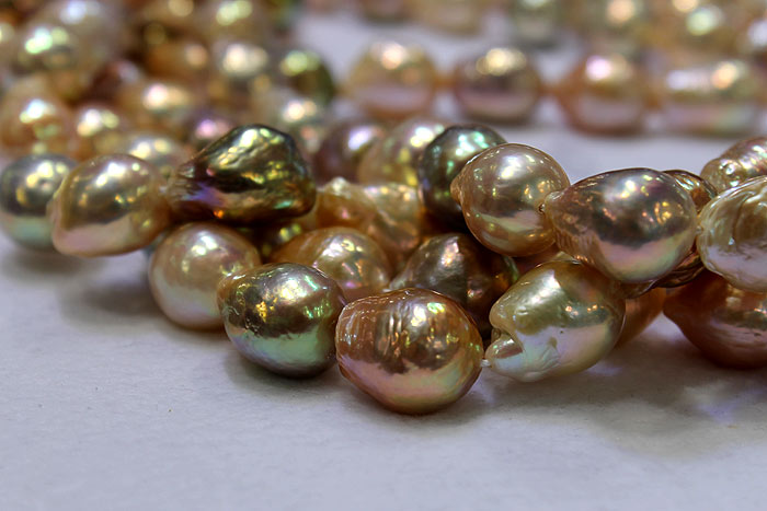 freshwater ripple pearls with a metallic sheen