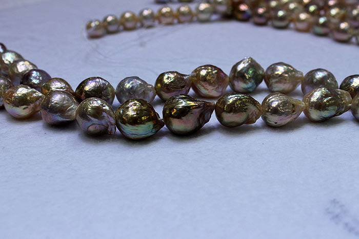a strand of dark colored ripple pearls