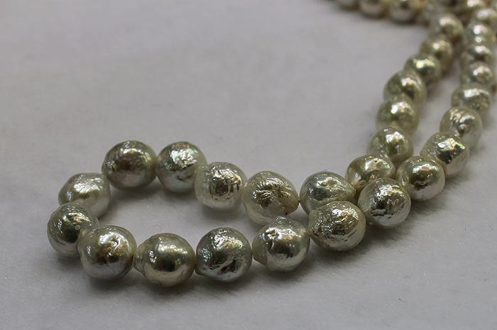 close up of a strand of baby ripple pearls