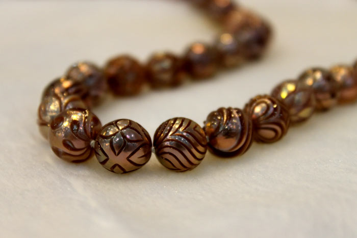 strand of Galatea pearls with different carved patterns