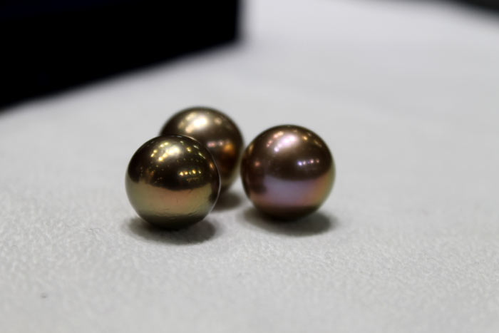 three perfectly round Edison pearls