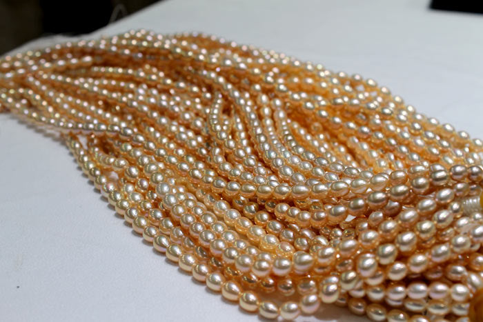 strands of golden peach freshwater pearls