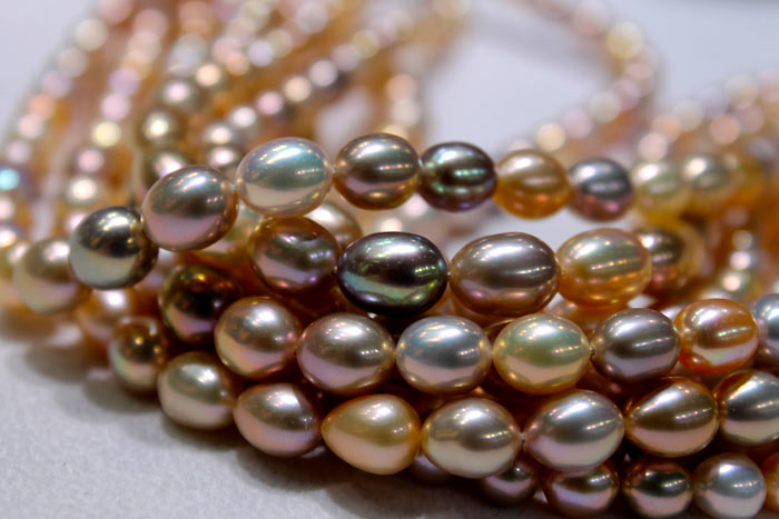 multicolored strands of metallic pearls