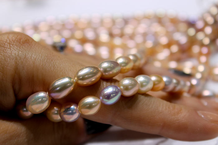 golden peach and multicolored pearl strands