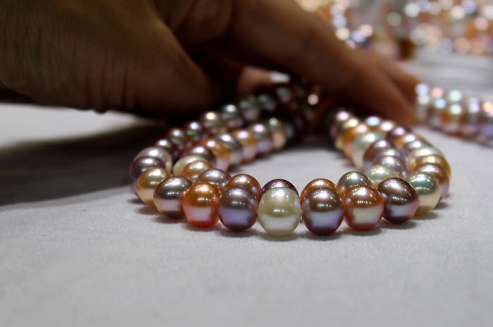 colorful strands of metallic pearls