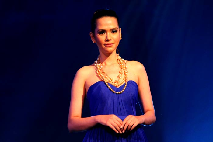 Golden South Sea Pearl jewelry on a deep blue dress