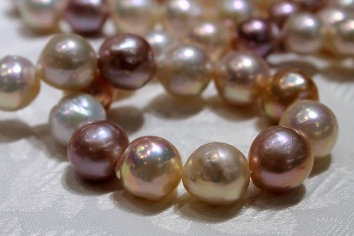 closer look at a multi-colored strand of ripple pearls
