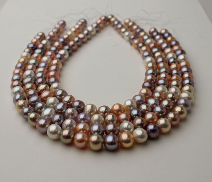 strands of metallic pearls in different colors