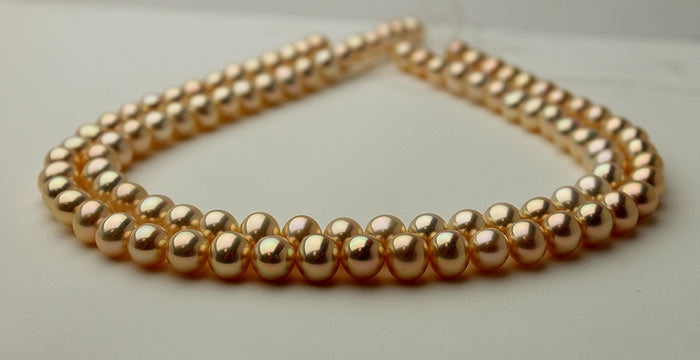 metallic pearls with golden-peach colors
