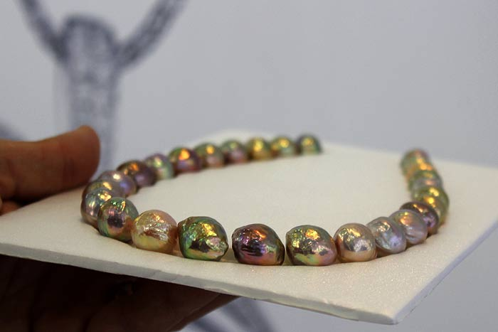 a perfect strand of colorful ripple pearls